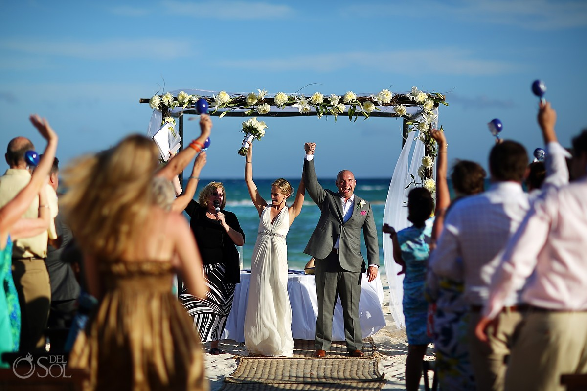 Beach wedding ceremony at Grand Velas Riviera Maya bride and groom ocean
