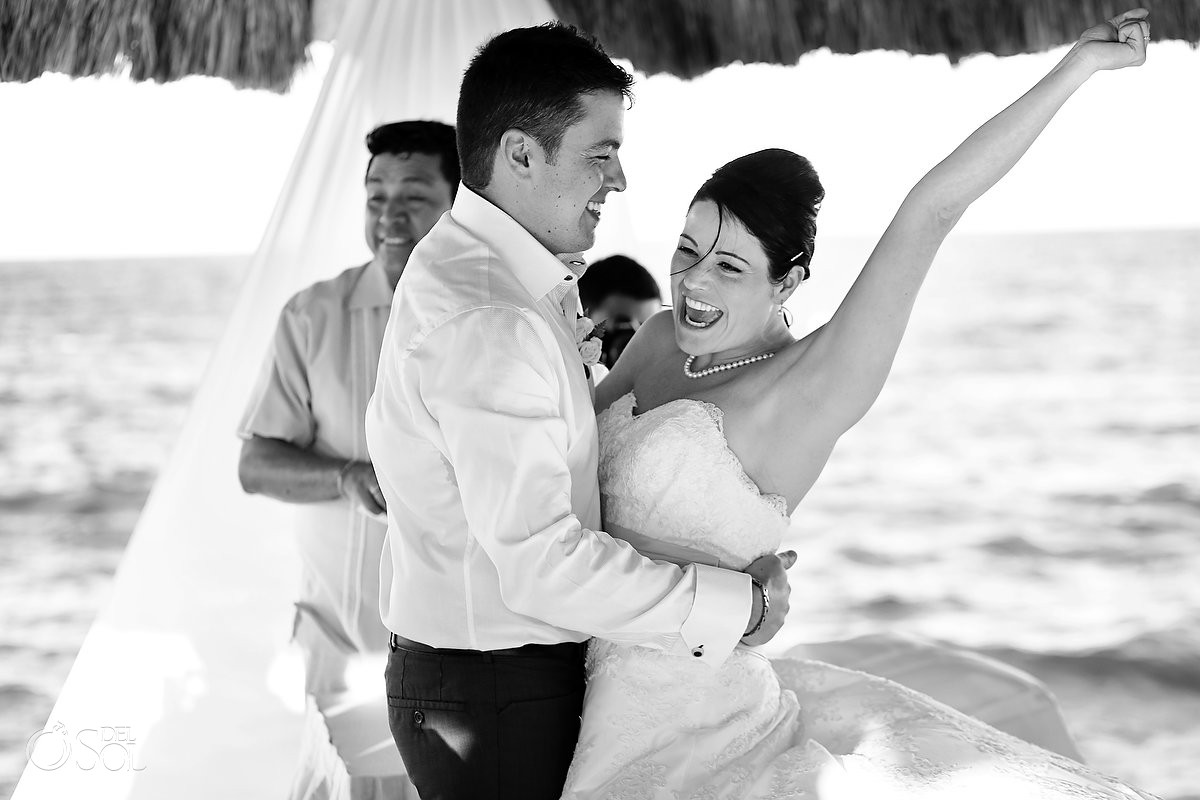 Bride and groom on dock in Mexico wedding