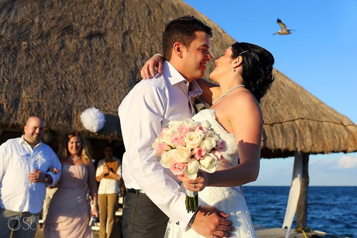 Bride and groom on dock Destination Wedding Mexico at Zoetry Paraiso la Bonita