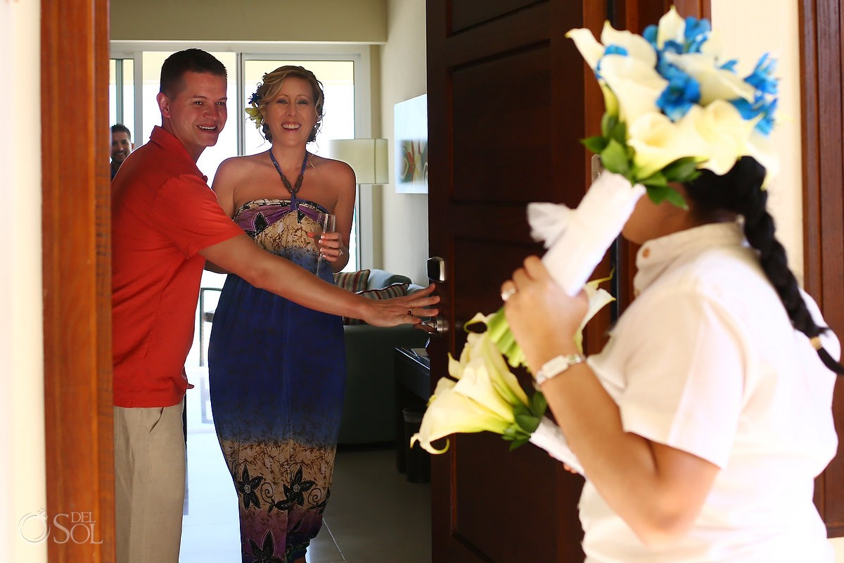 Bride receives bouquet in hotel room at Now Jade Resort