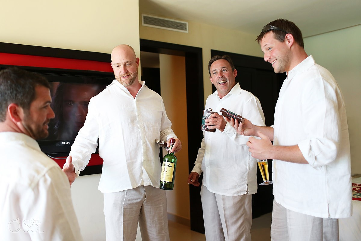 Groomsmen in a hotel room before wedding with whisky
