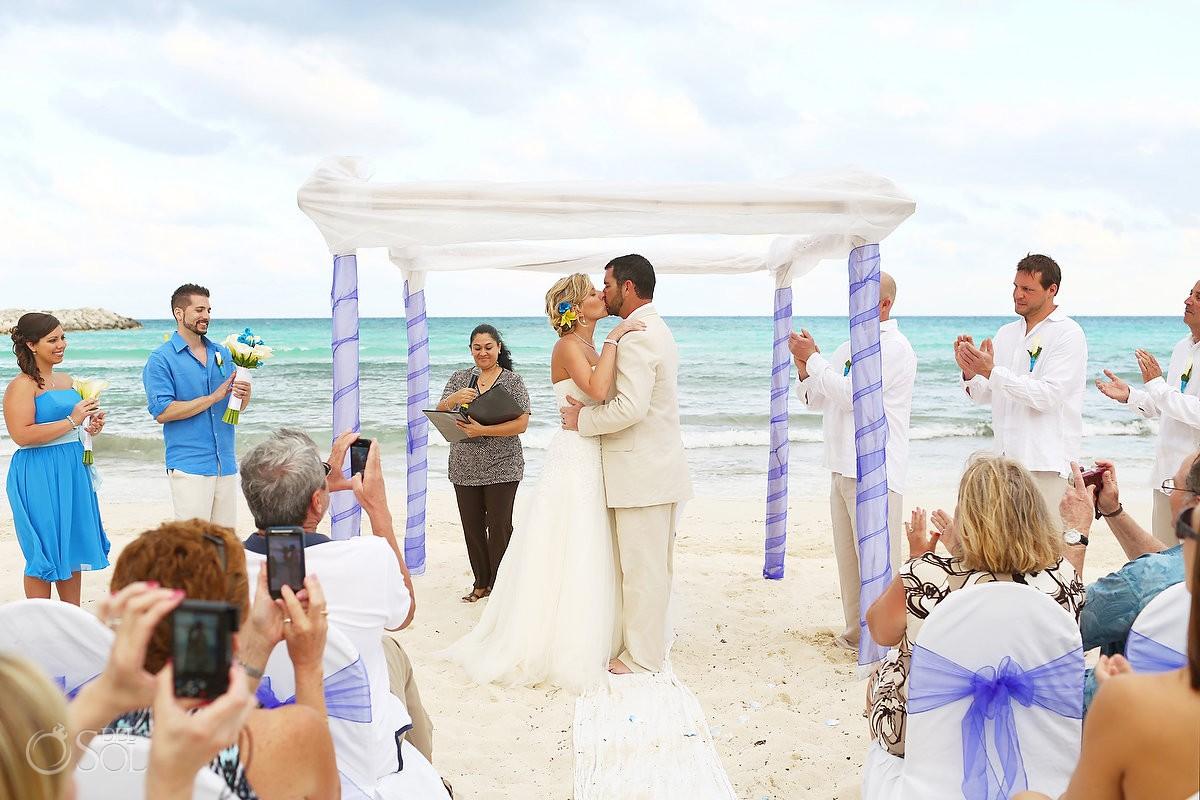 Bride groom kiss beach wedding Mexico
