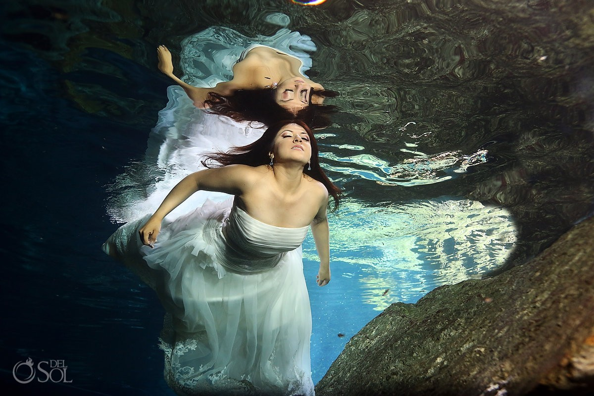 Underwater bride in a cenote in the Riviera Maya trash the dress