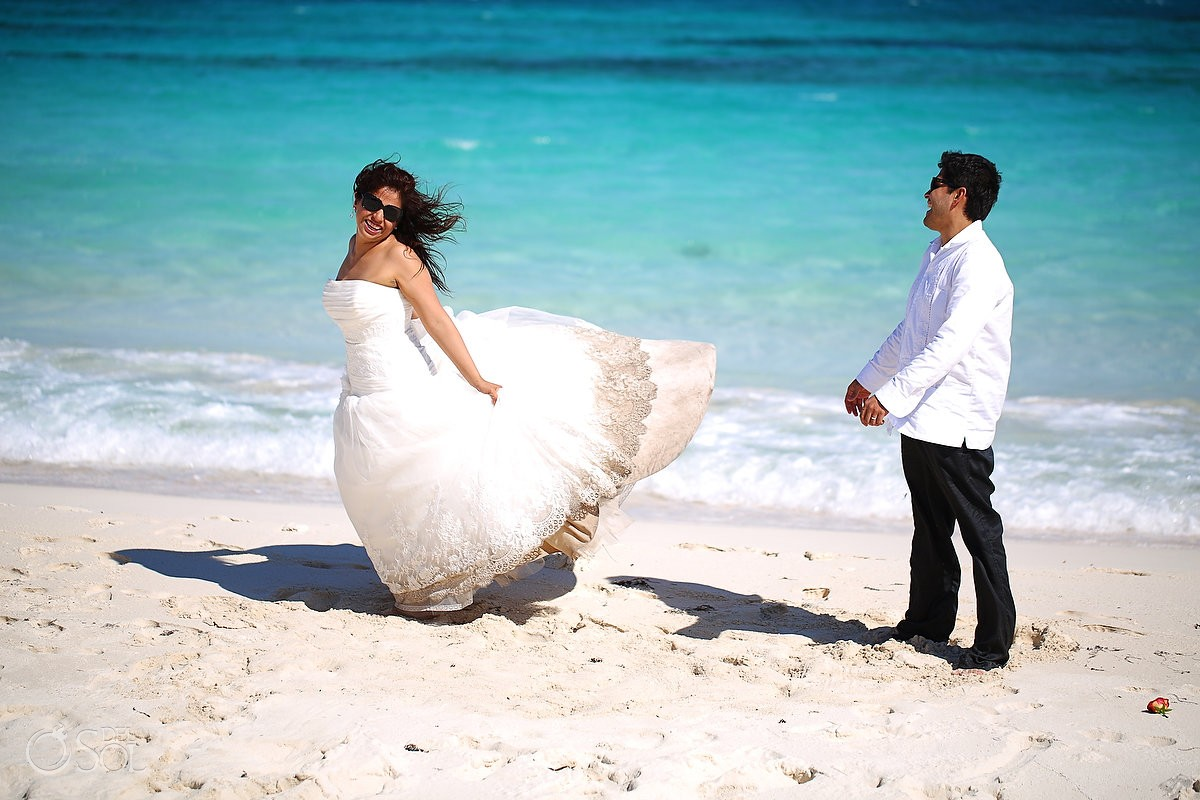 Bride and groom on the beach in the Mexican Caribbean Riviera Maya.