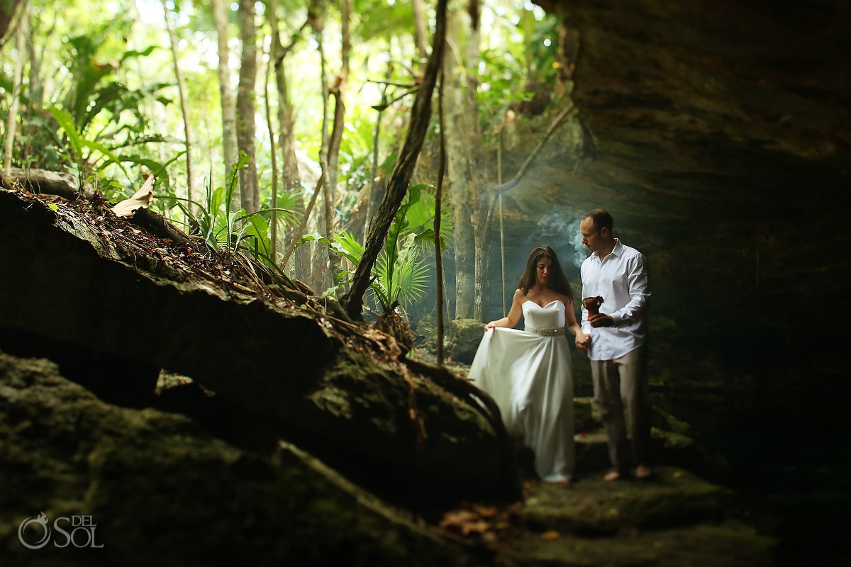 Bride and groom in a cenote trash the dress photo shoot