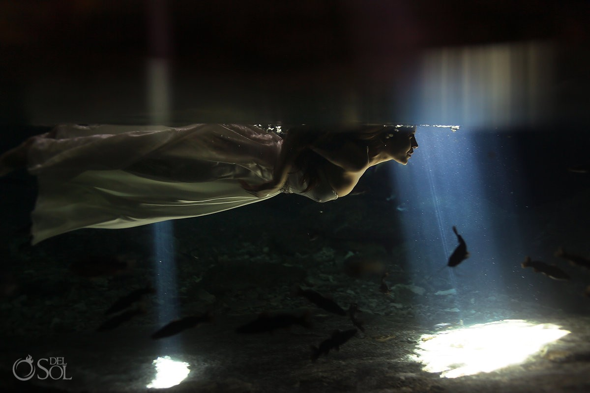 Underwater bride in a cenote trash the dress