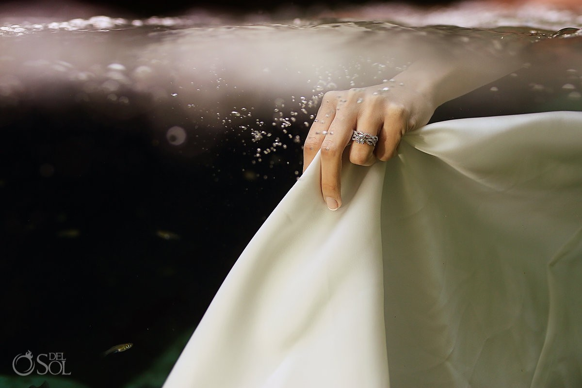 Engagement ring and wedding dress underwater in a cenote trash the dress photo shoot