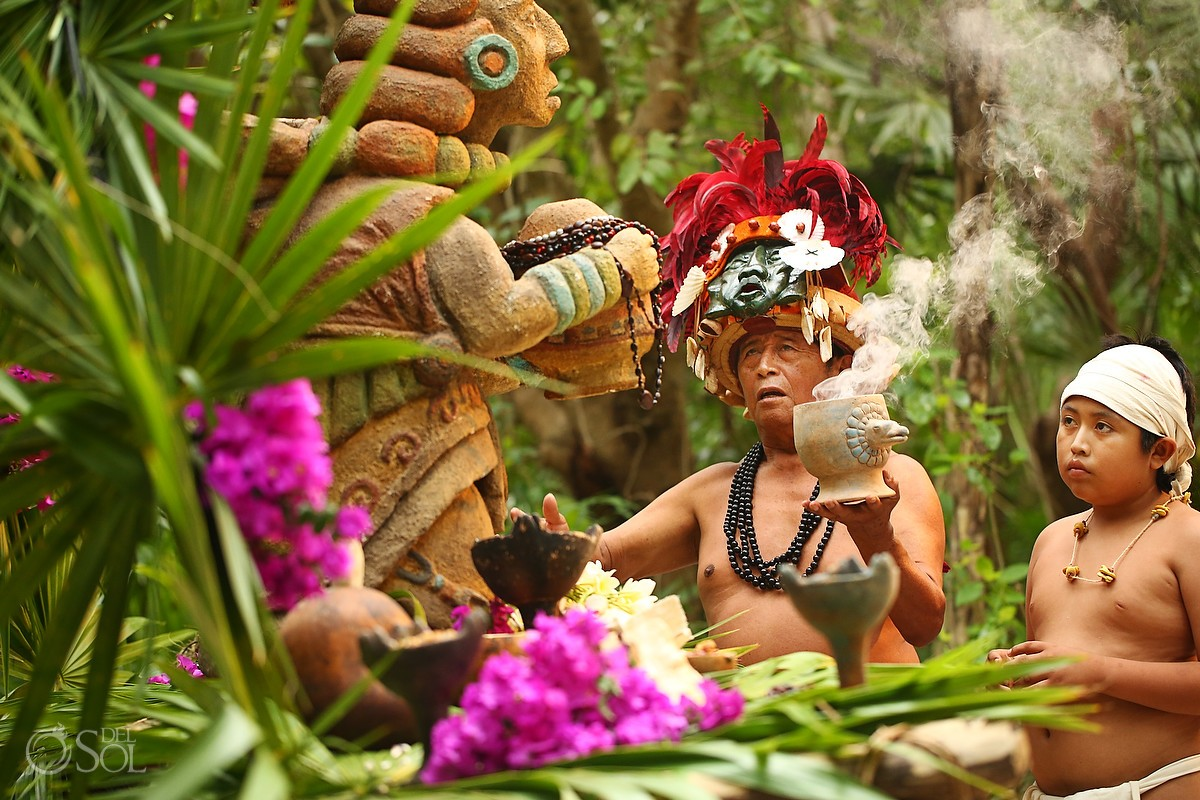 copal blessing by Mayan priest at sacred statue Xcaret Park Riviera Maya Mexico