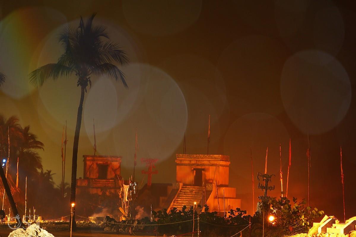 Xcaret Park Mayan village in the dark before the Travesia Sagrada Maya