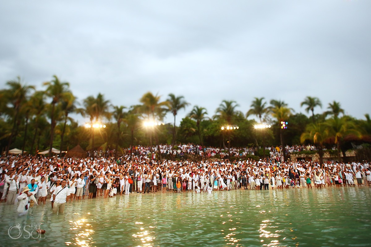 Crowd of supporters on the beach Xcaret Park Travesia Sagrada Maya