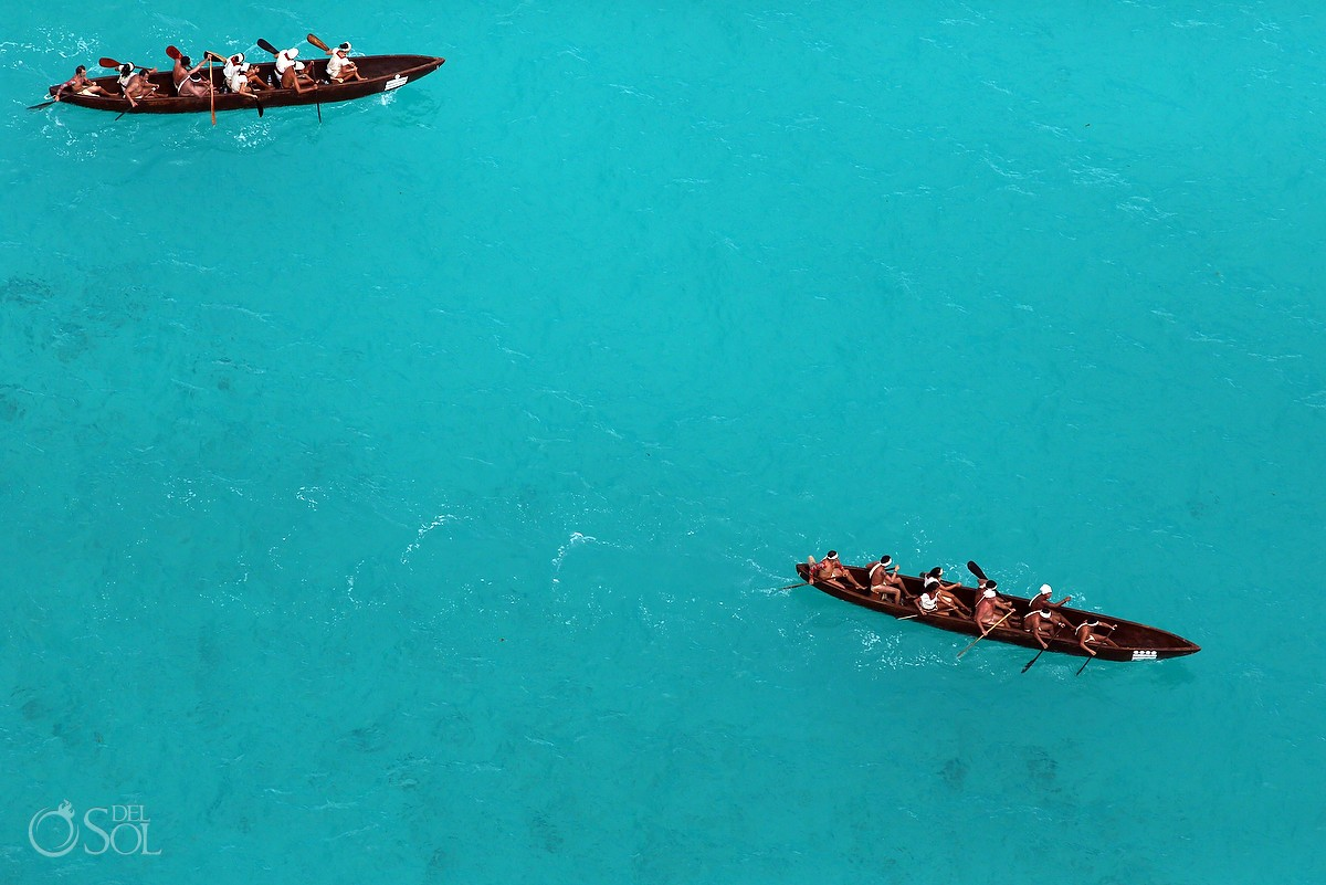 Travesia Sagrada Maya canoes from the aerial view in the sea