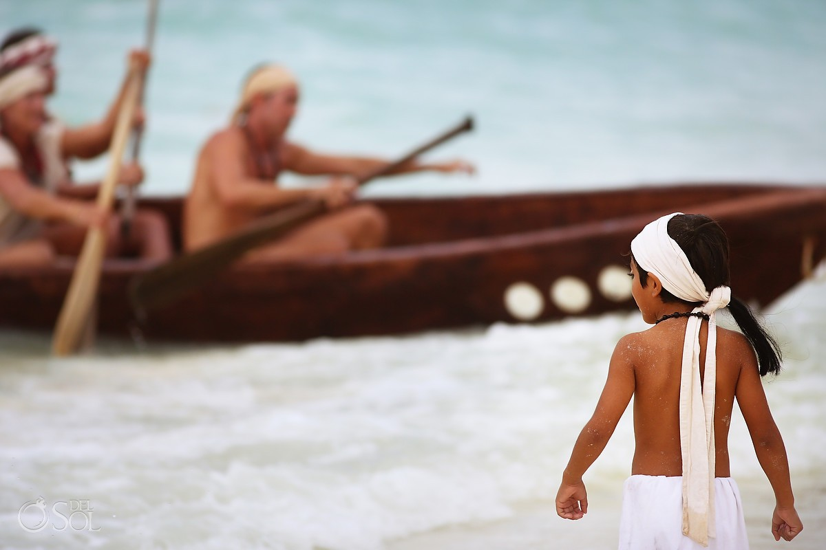 Sacred Mayan Journey child welcomes canoes