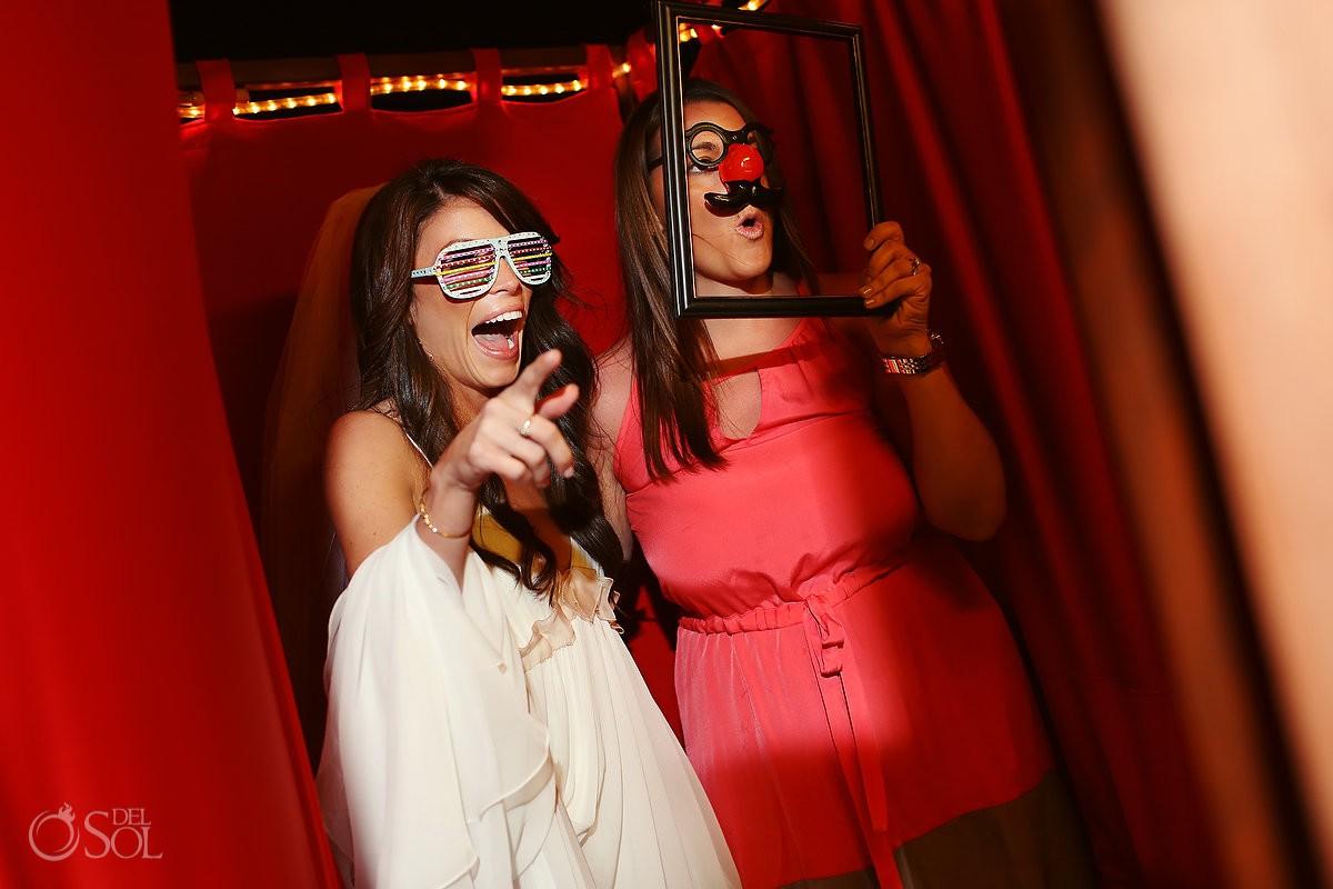 Fun bride in photo booth