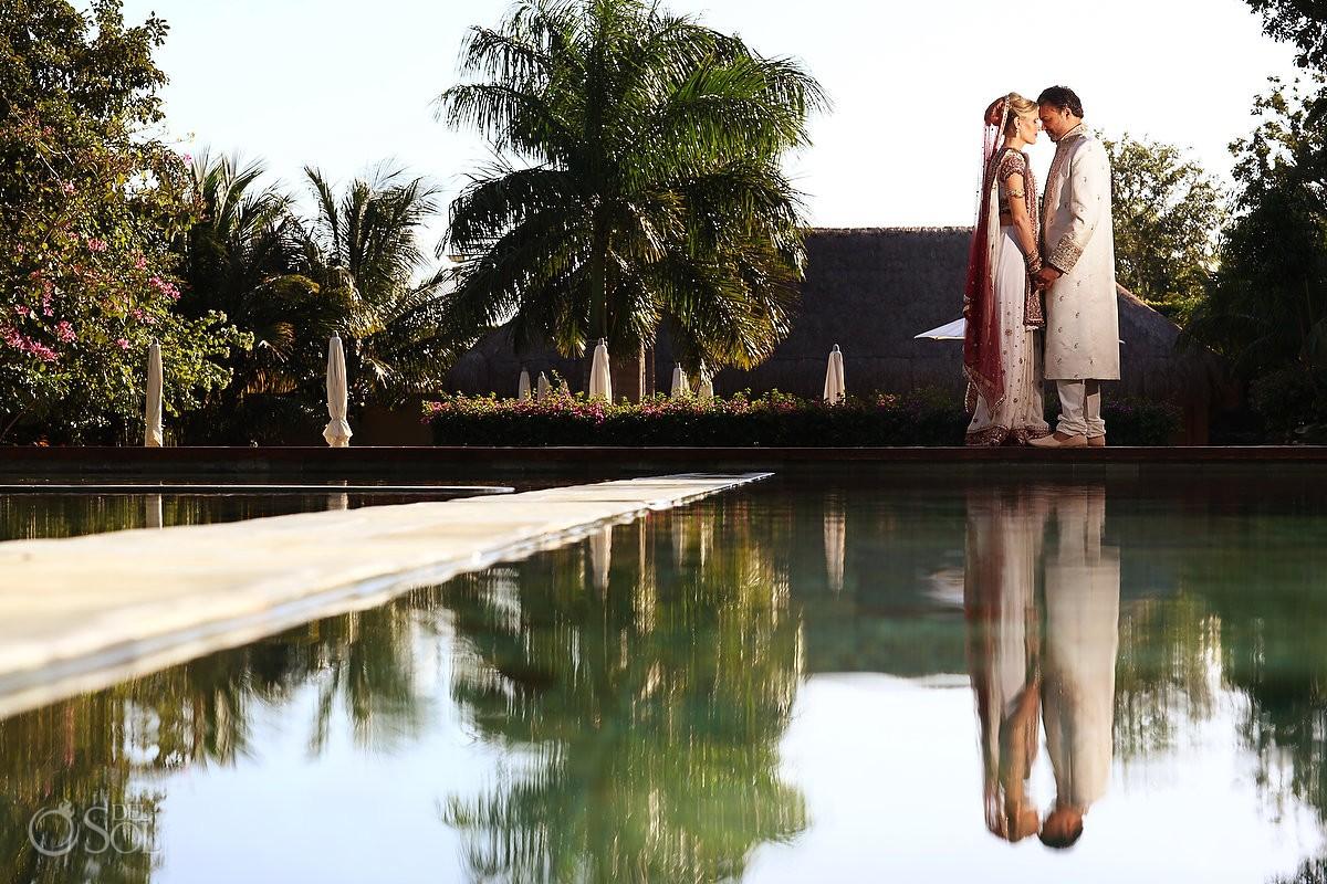 Hindu wedding portrait bride groom pool reflection Grand Velas Resort, Riviera Maya Mexico