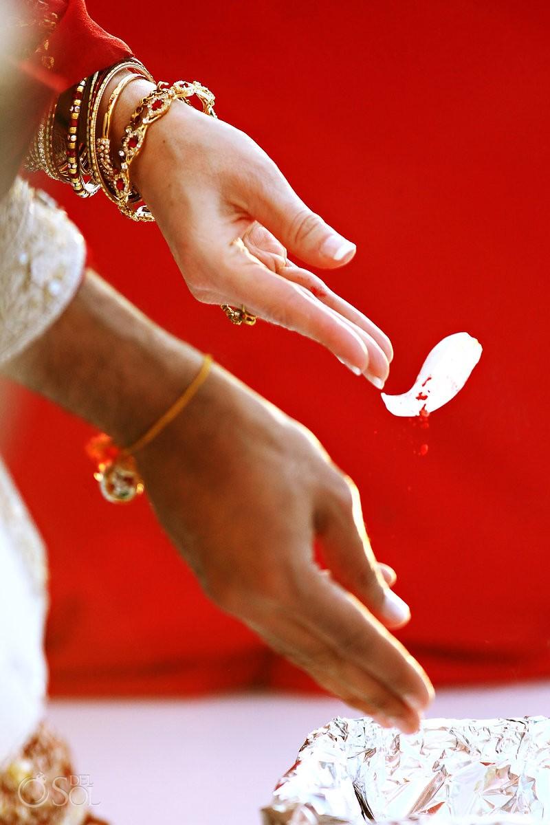 Hindu wedding tradition bride groom hands offering throwing petals , Zen Garden, Grand Velas Resort, Riviera Maya, Mexico