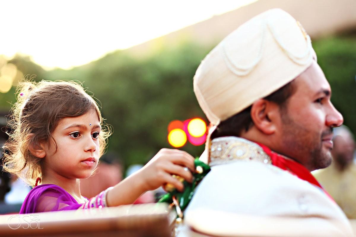 Cute child touches groom's back Hindu wedding, Zen Garden, Grand Velas Resort, Riviera Maya, Mexico