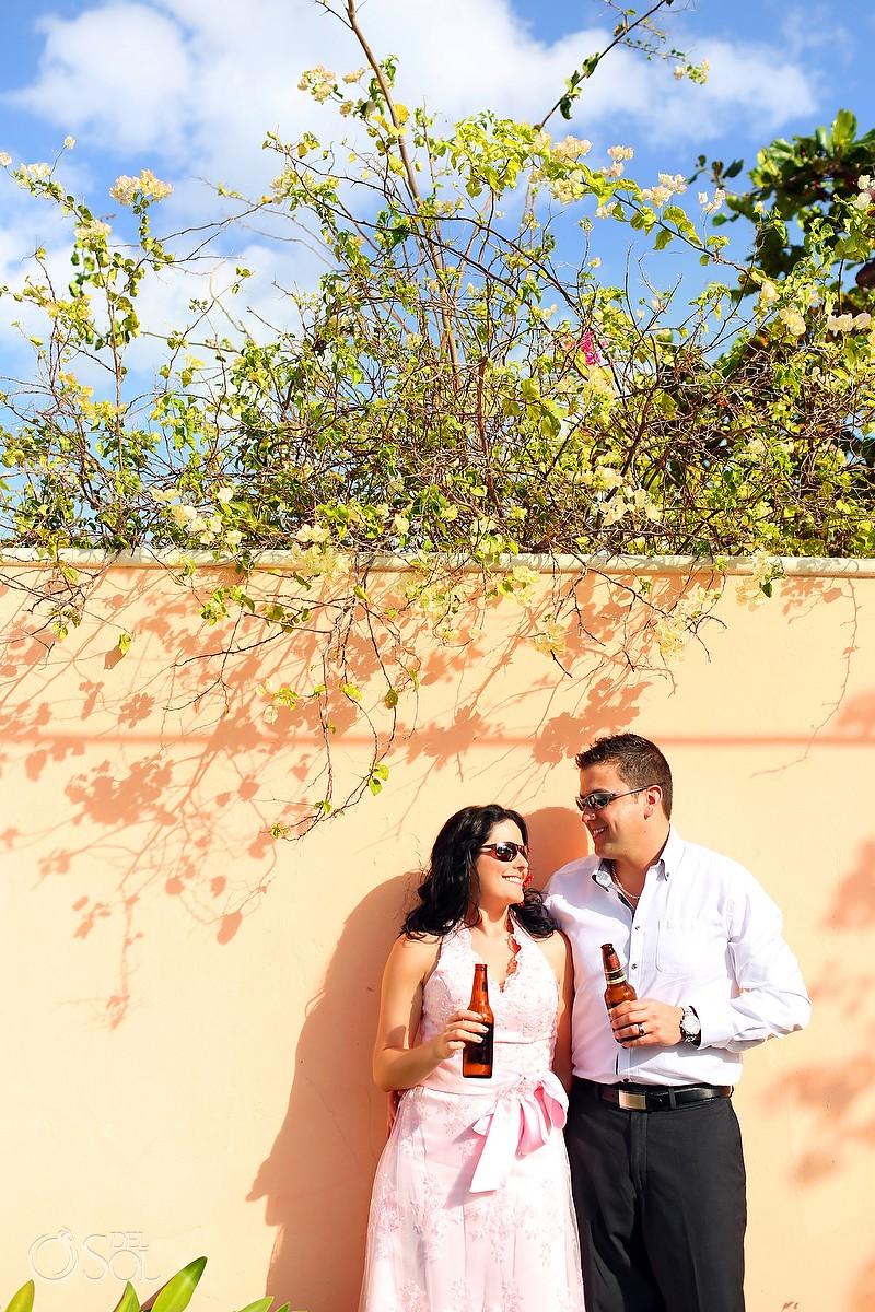 Bride and groom having a beer