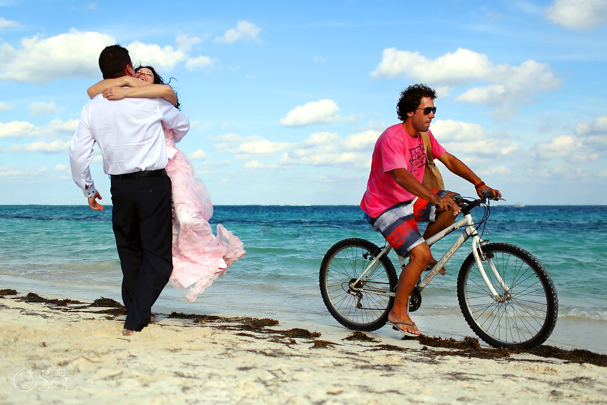 Bride and groom on the beach in Mexico, bike rides by