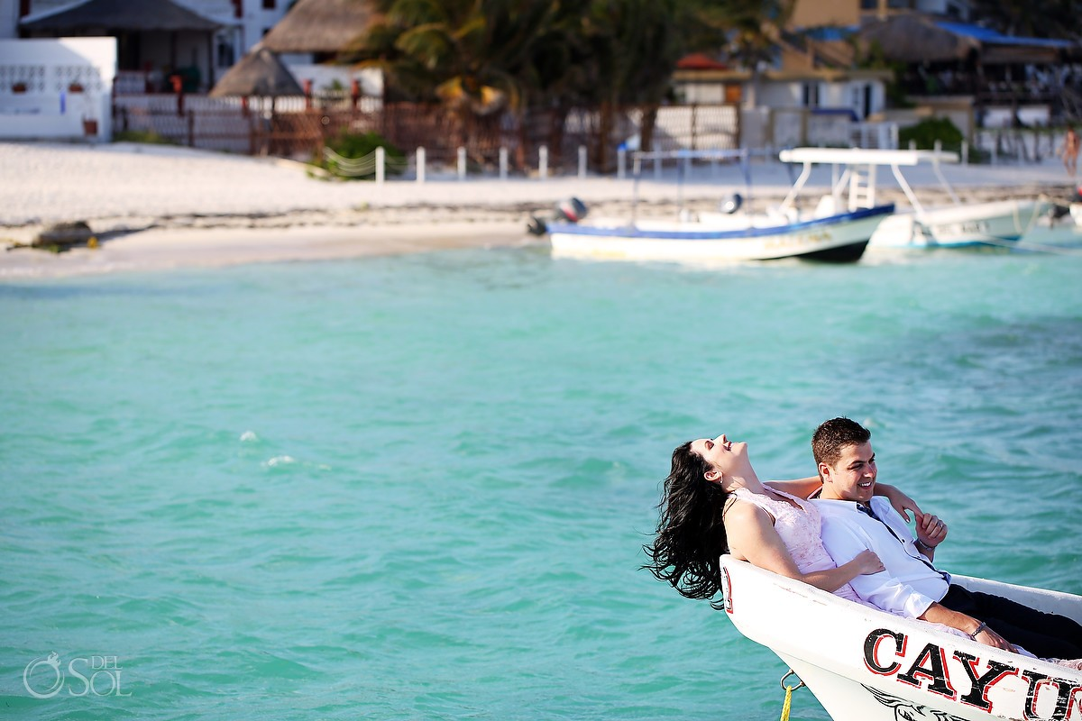 Bride and groom in a panga boat in Puerto Morelos Mexico