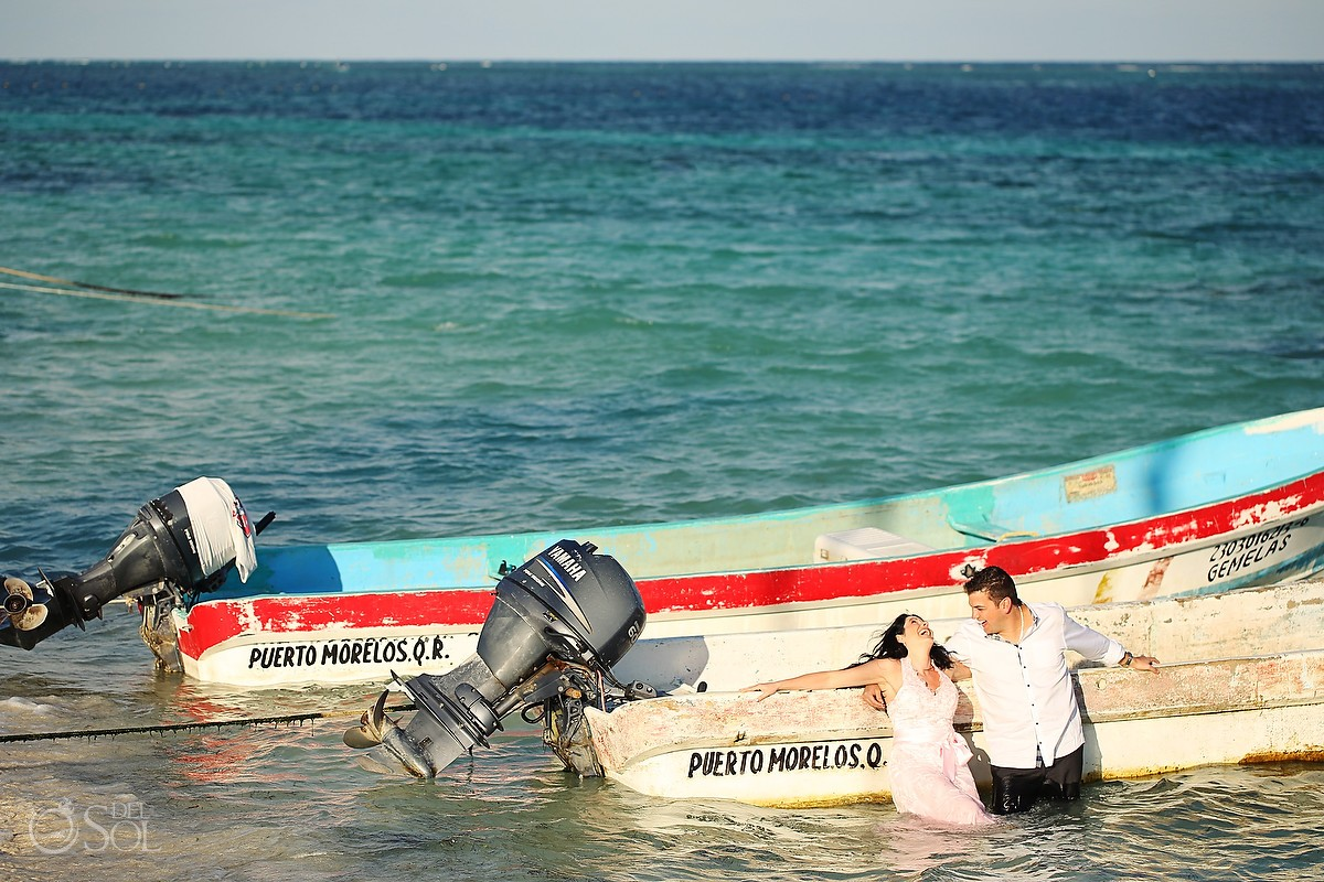 Bride and groom in the Mexican Caribbean beside a boat
