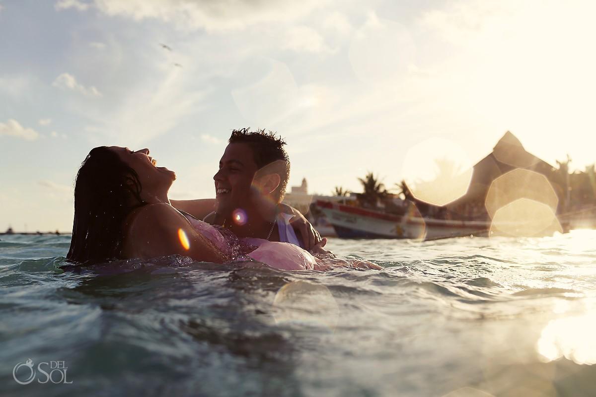 bride and groom swimming ocean Puerto Morelos trash the dress
