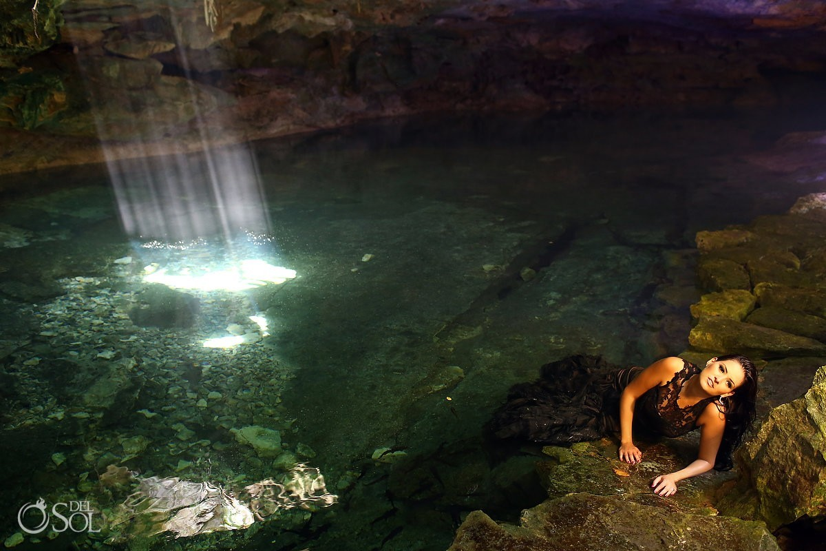 Cenote trash the dress in Vera Wang black wedding dress