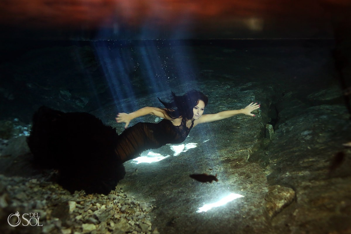 Underwater trash the dress black Vera Wang gown