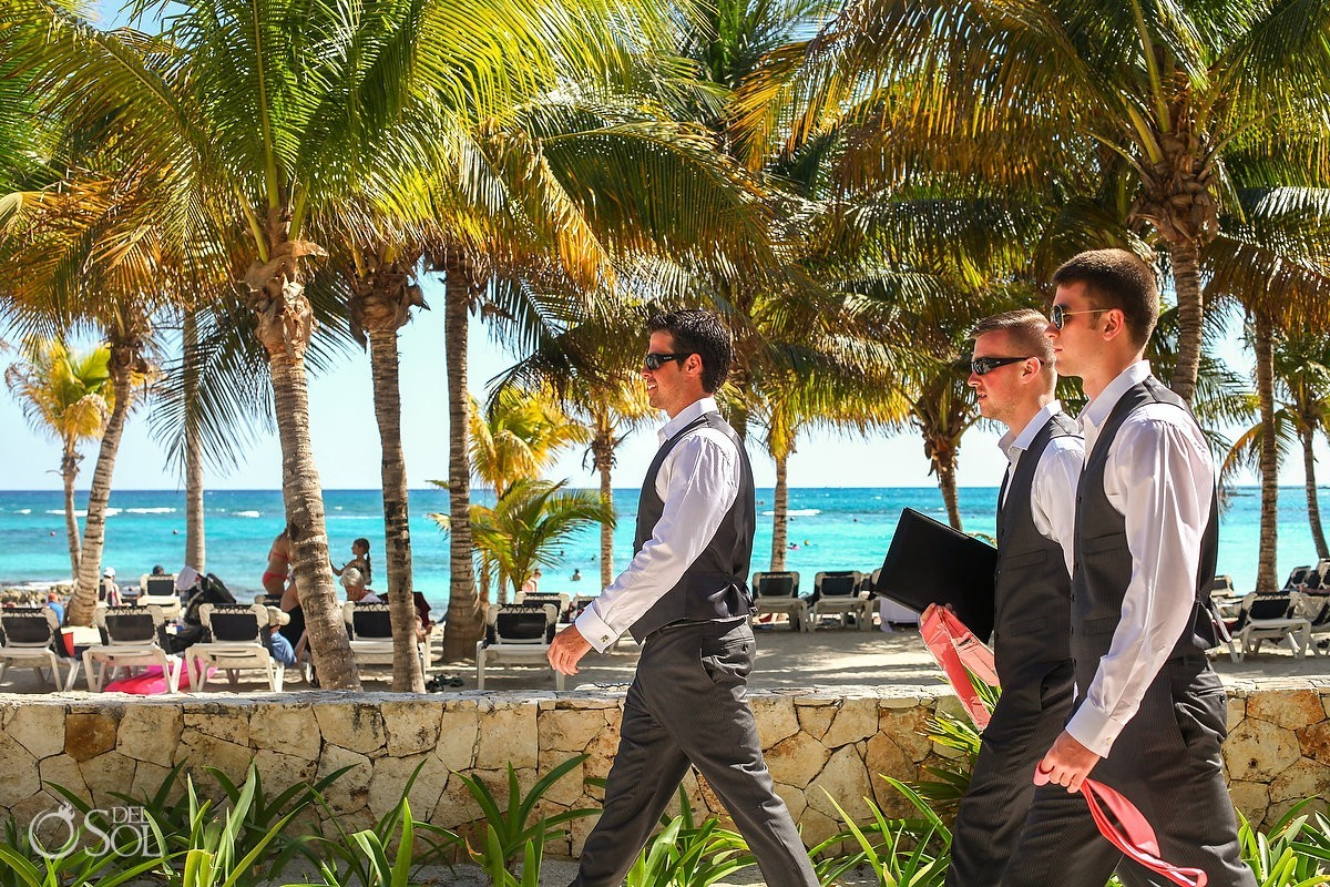 Palm trees and ocean for groom and his ushers