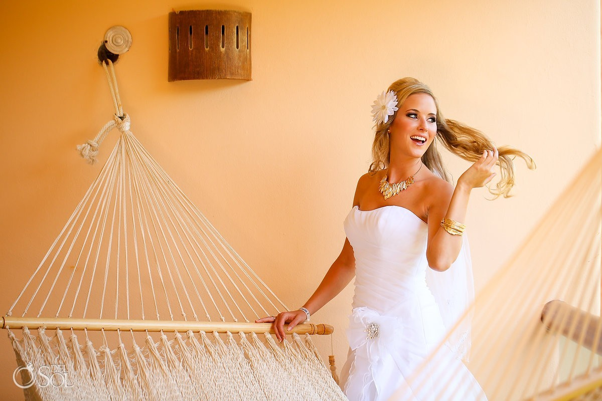 Hammock for a blonde bride in strapless gown by Alfred Angelo