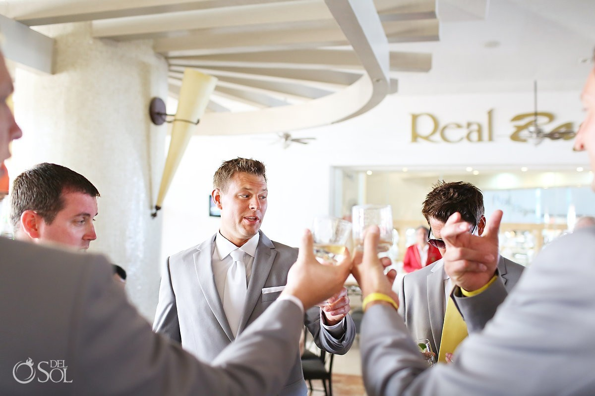 Groom and ushers toast drink in Cancun