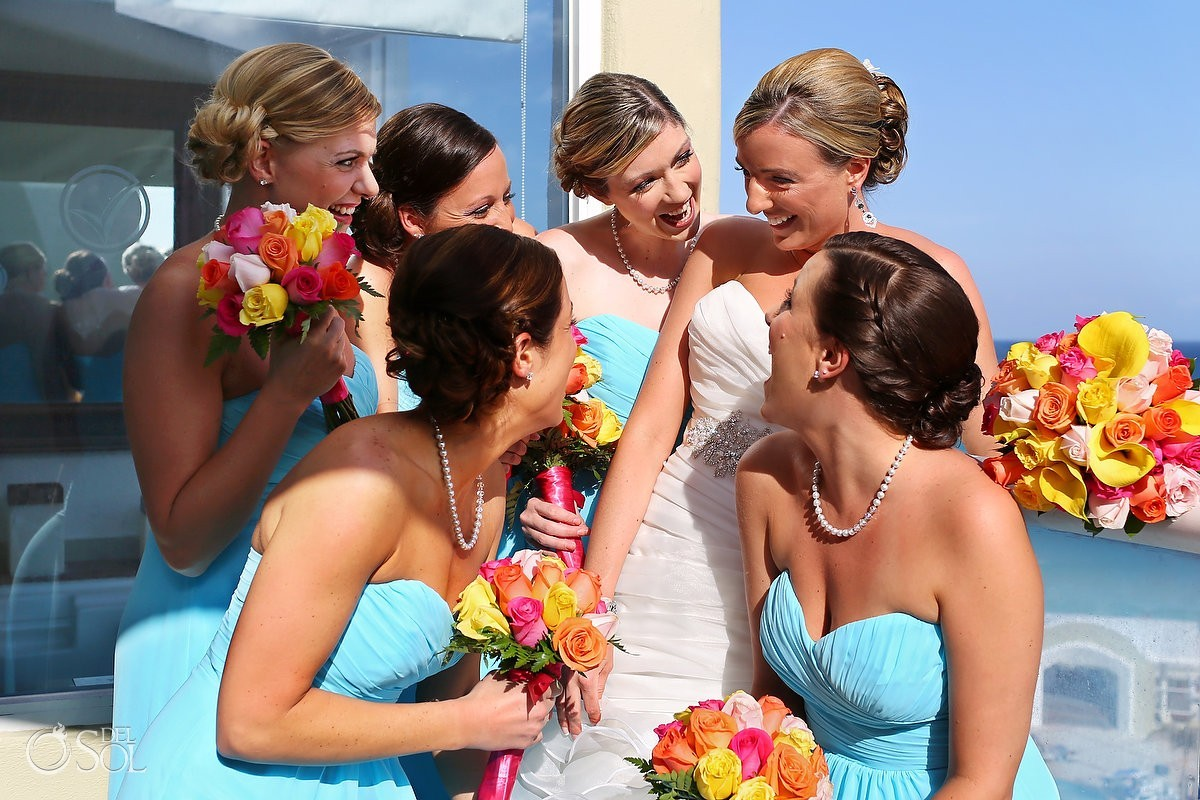 Cancun bride and bridesmaids laughing