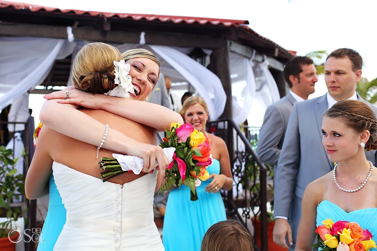 Cancun bride hugging her bridesmaid