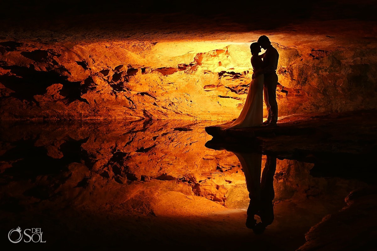 Silhouette in a cave cenote in Riviera Maya bride and groom