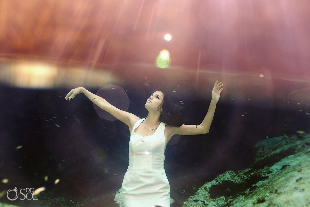 Underwater bride in a cenote Riviera Maya trash the dress