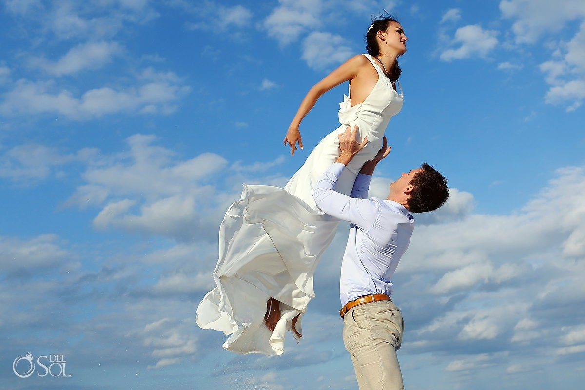 Beach trash the dress Riviera Maya Mexico, groom lifts bride