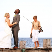 Fisherman kid photobombs bride and groom destination wedding