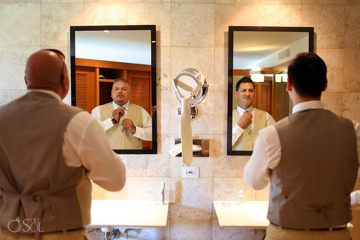 Riviera Maya groom and usher in bathroom