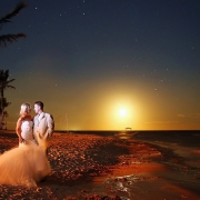 Bride and groom on the beach under moonlight at dreams tulum hotel