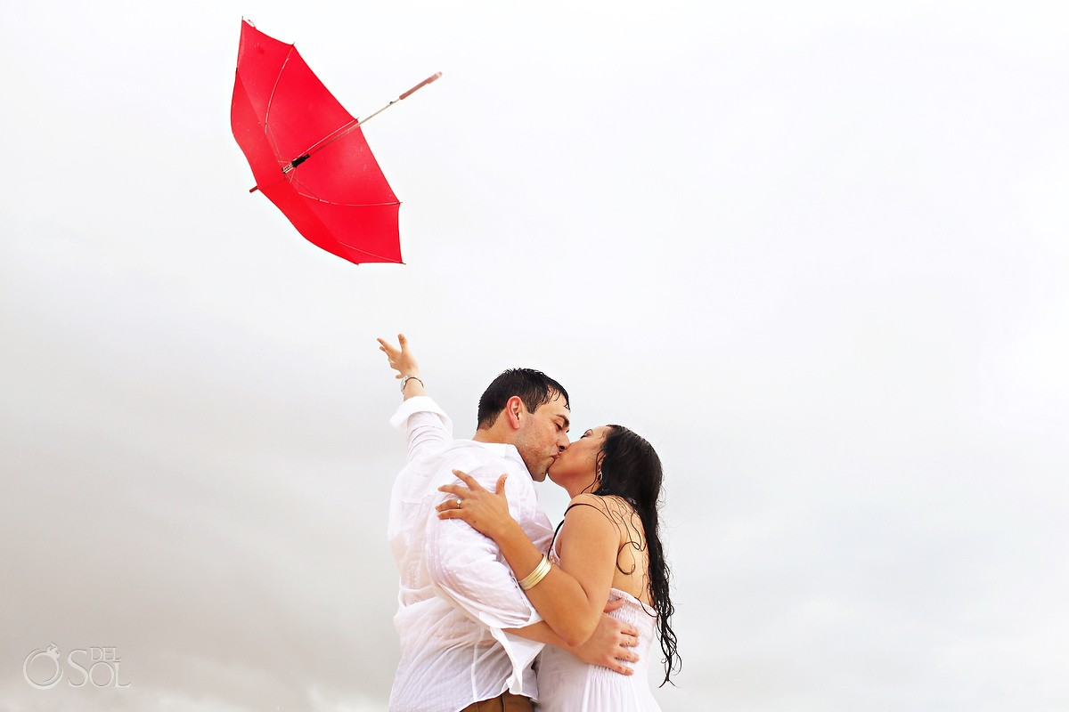 huffington post del sol photography feature bride and groom with umbrella and rain