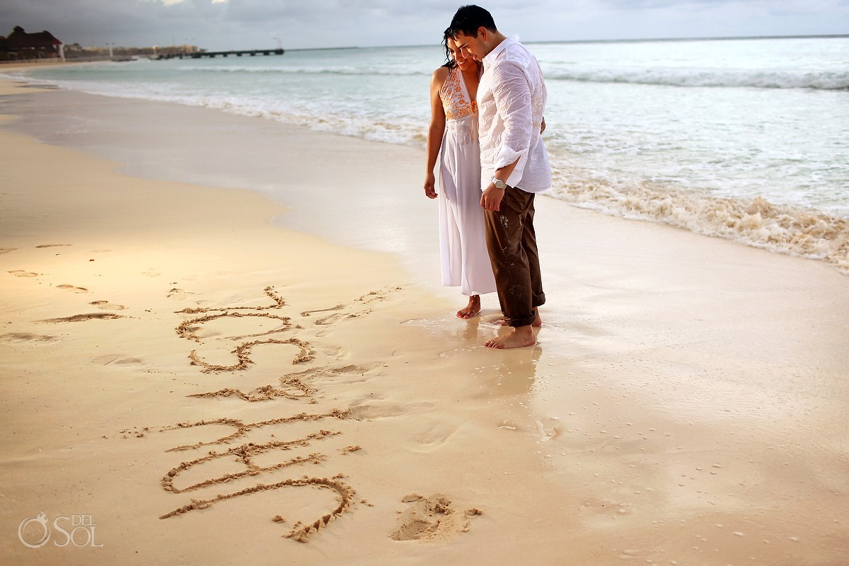 Engagement portrait photo shoot sand writing