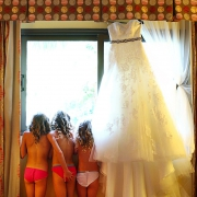 three flowergirls stand next to bridal gown at barcelo mayan palace