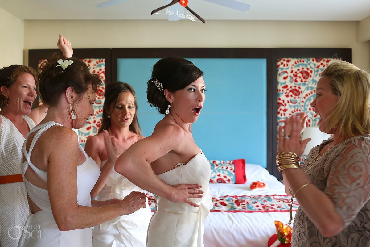 Putting on bridal gown Destination Wedding Now Jade