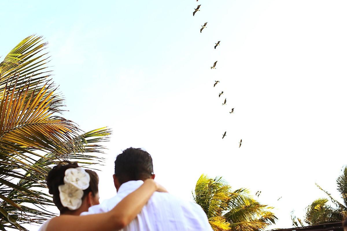 Riviera Maya wedding bride birds in sky