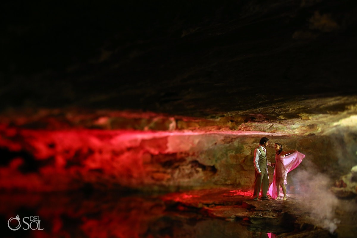 Bride and groom trash the dress in cenote