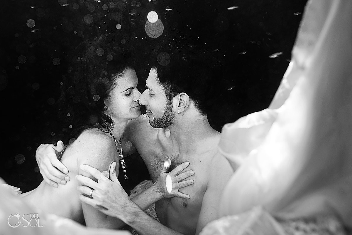 Black and white bride and groom underwater cenote cavern