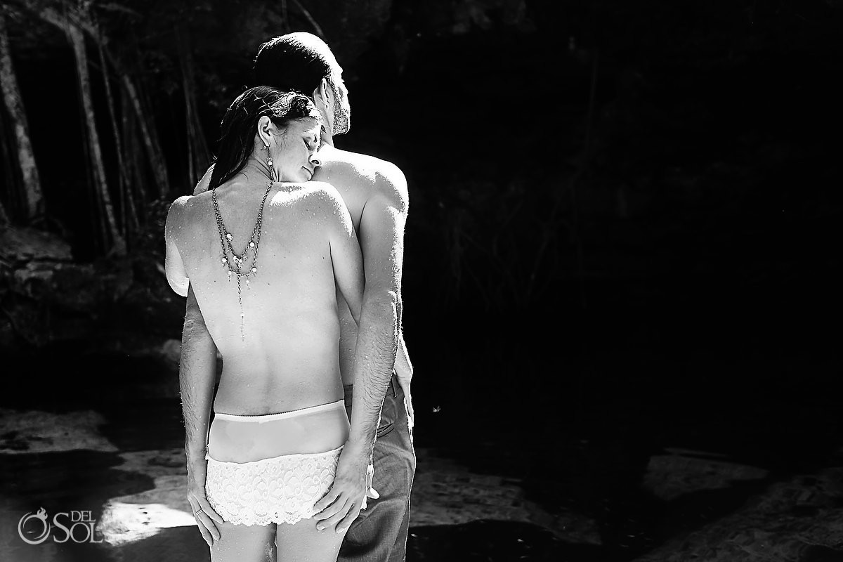 Bride and groom in underwear black and white shot in a cenote Riviera Maya