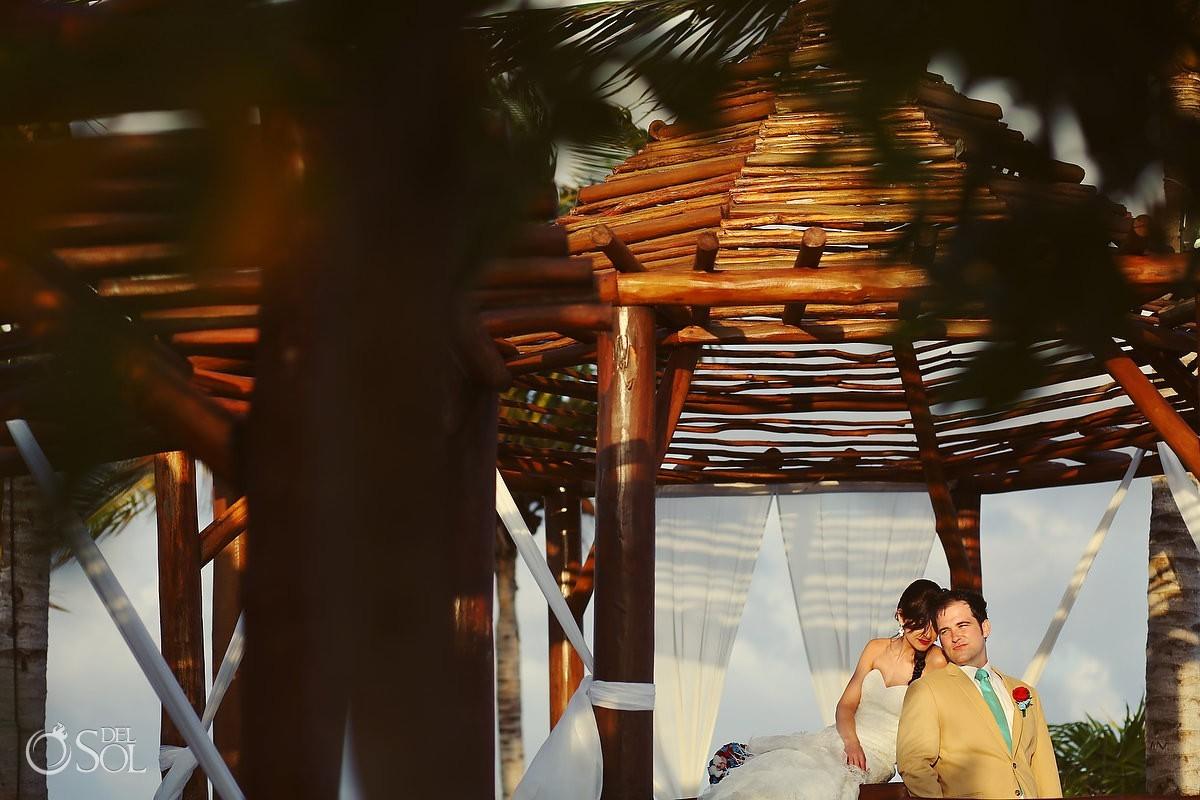 Bride and groom in a destination wedding in a gazebo in Mexico