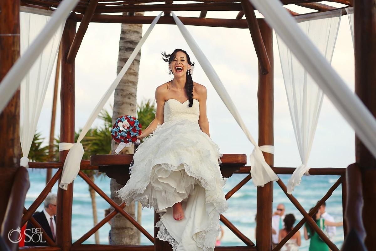 Mexico wedding bride laughing in gazebo