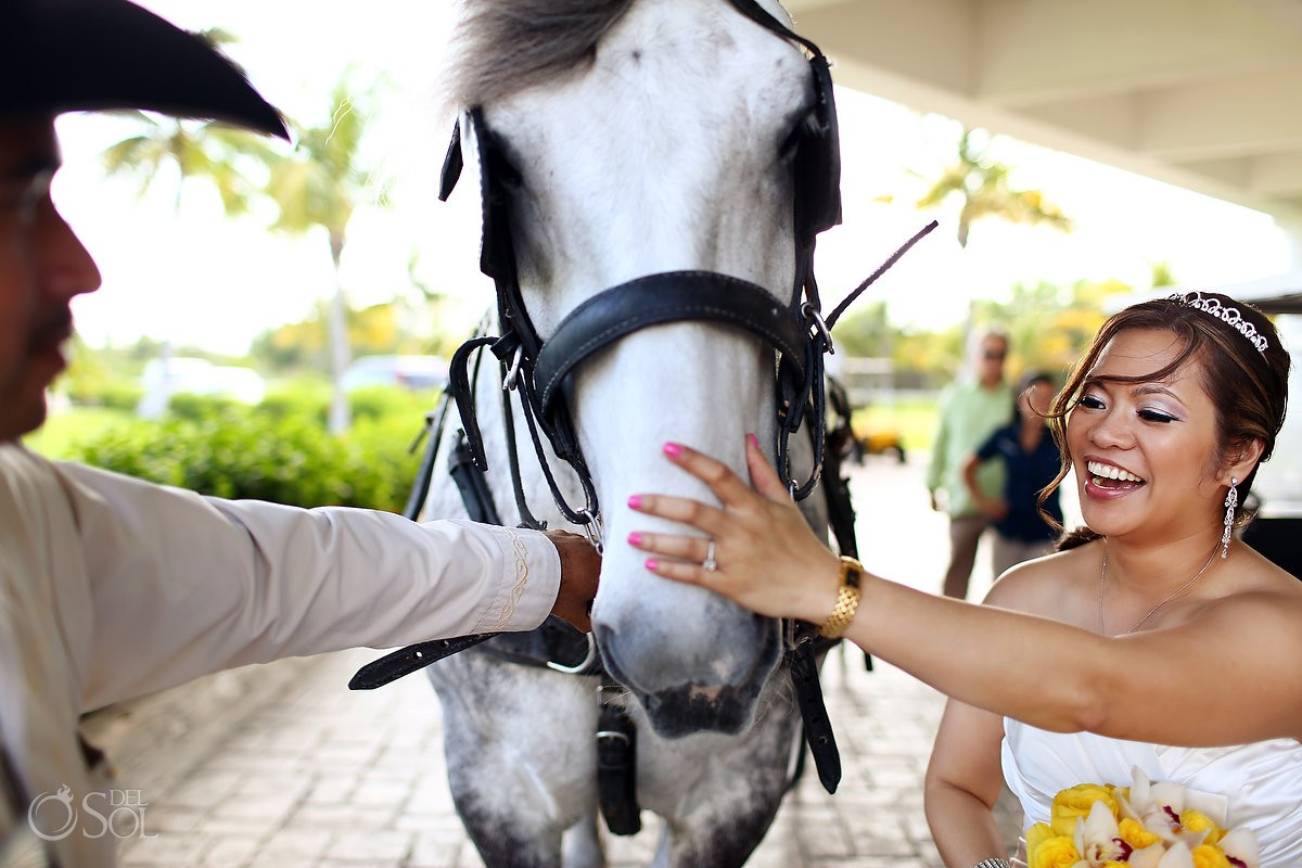 Bride and horse drawn carriage Cancun wedding Moon Palace