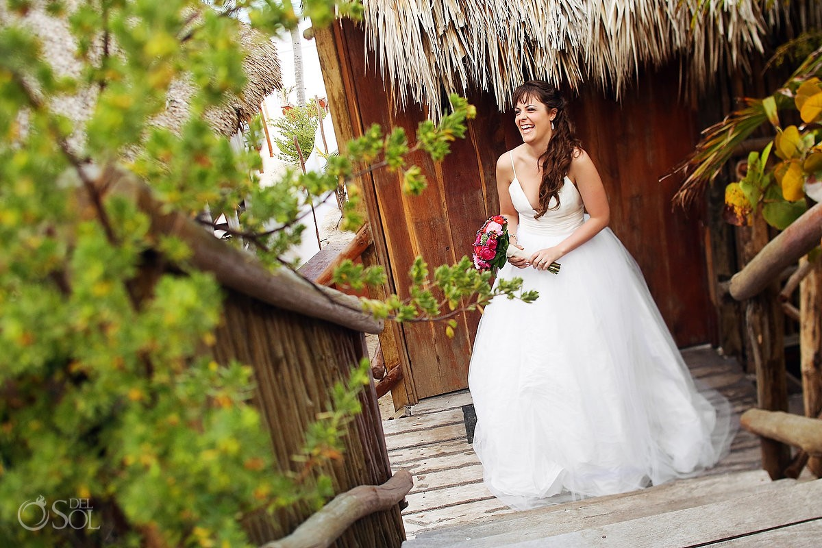 Bride wooden stairs palapa
